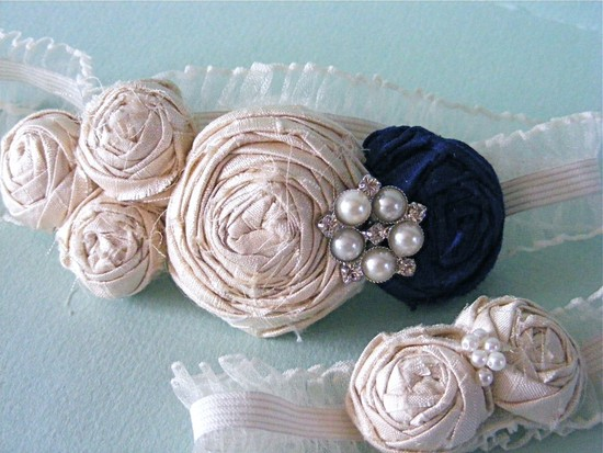 photo of Ivory and Navy Silk Rosette Garter Set