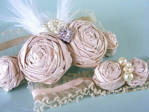 photo of Elegant Ivory Bridal Garter Set
