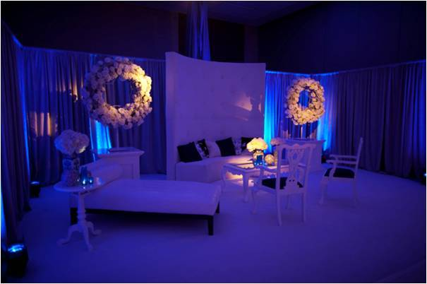 Serene-wedding-reception-decor-white-wedding-flowers-blue-lighting-lounge-vibe.full