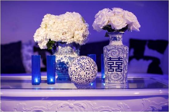 Antique vases for 'something old', white wedding flowers and blue lighting