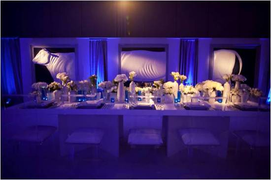 Something Blue wedding reception room with all-white flowers