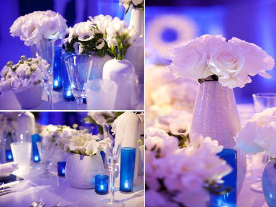 Modern wedding reception decor- blue lighting, white flowers and lounge furniture