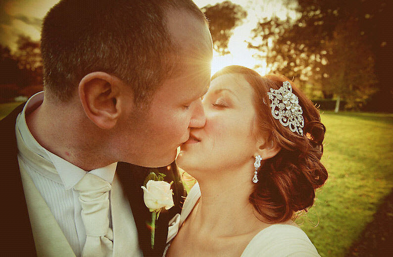Real-irish-wedding-bride-groom-kiss-outside-venue-wedding-photography_0.full