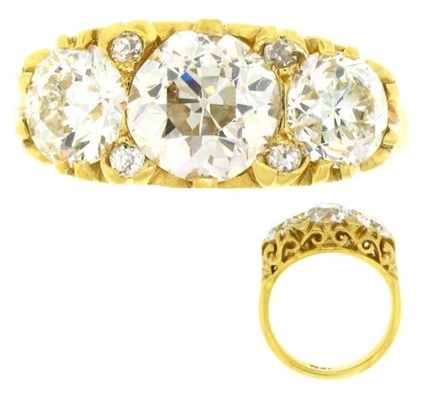3 Old Mine cut diamonds set in yellow gold engagmeent ring