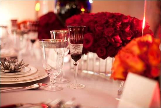 Organic red roses arranged in stunning wedding reception centerpiece
