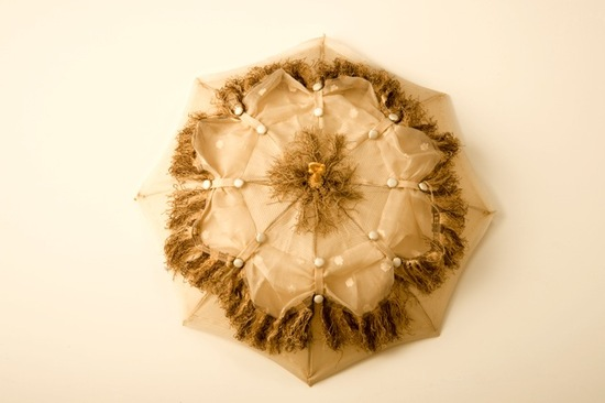 Organic vintage wedding parasol with ivory silk buttons and green fringe