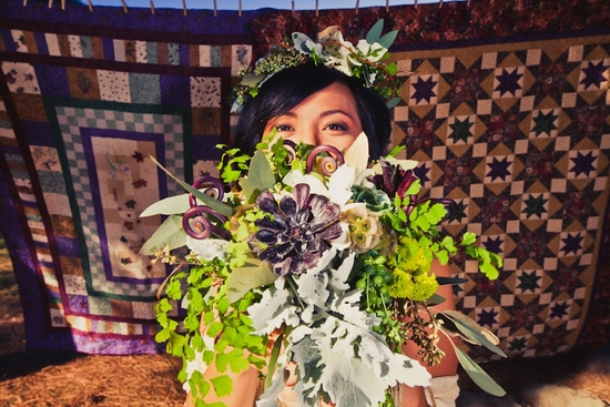 Flower child California bride wears crown of flowers, holds eco-chic bouquet