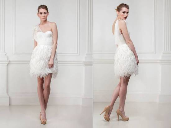 White one-shoulder wedding reception dress with feather-embellished skirt
