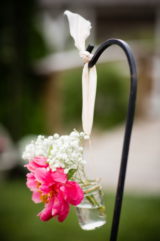Ceremony decor with peonies and shepard hooks