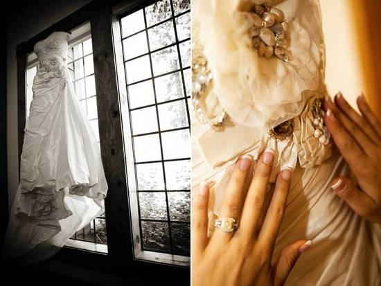 Ivory embellished wedding dress hangs in window on wedding day