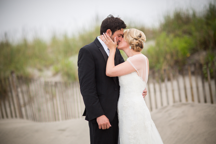 Real_wedding_couple_kiss_on_the_beach.full