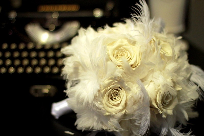 Ivory-bridal-bouquet-roses-feathers.full