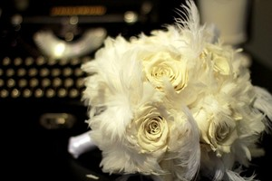 photo of Romantic feathers adorn bridal bouquet and bout