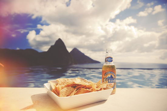 Chips and a Piton beer looking over the Pitons in St Lucia