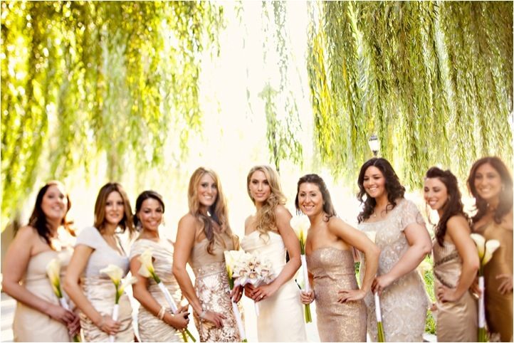 Bridal party wears mix and match gold, champagne and taupe bridesmaids' dresses