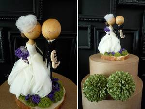 photo of Cute bride and groom wedding cake topper