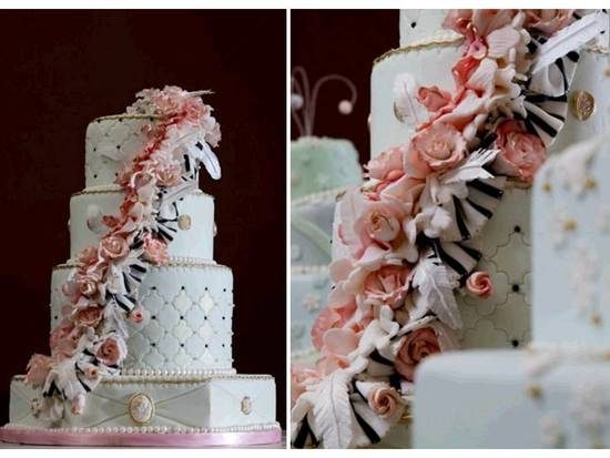 Regal fairytale-inspired wedding cake with gold leafing
