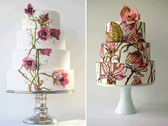 White wedding cakes adorned with colorful flowers and butterflies for Spring wedding