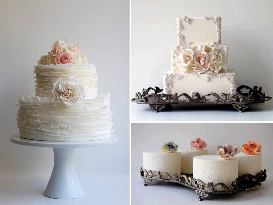 Classic white wedding cakes with romantic floral and pearl detail