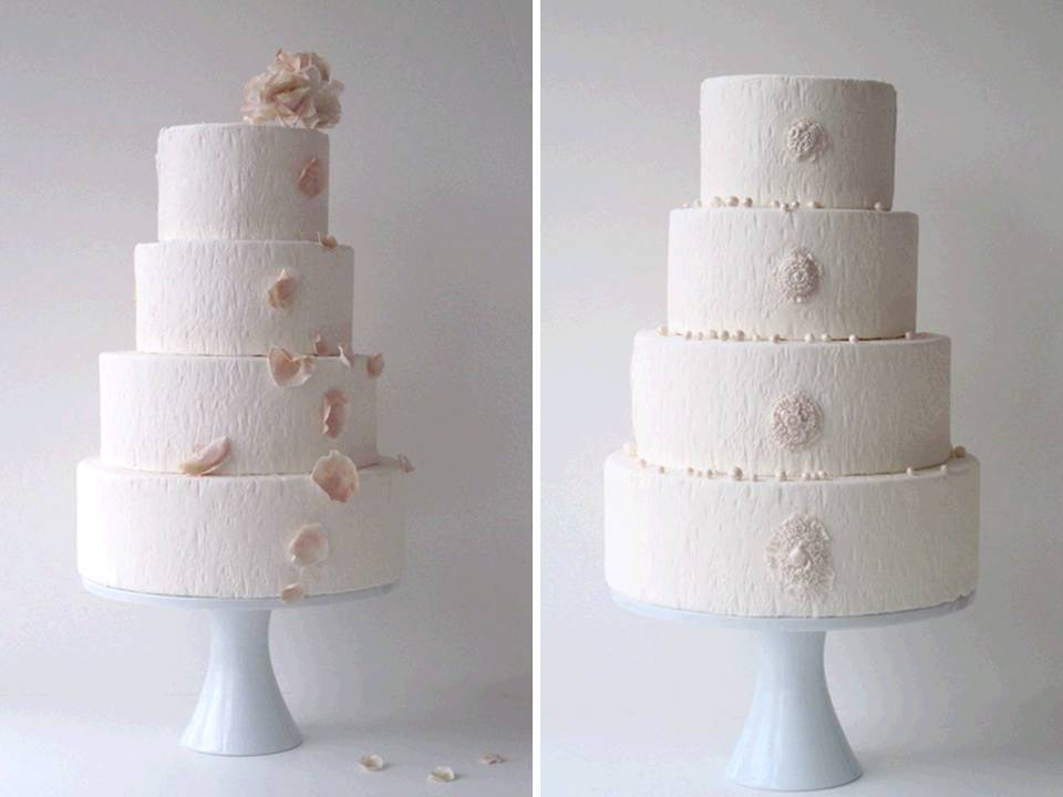 Classic-wedding-cakes-4-tier-white-stacked-wedding-cake-adorned-with-flowers.full