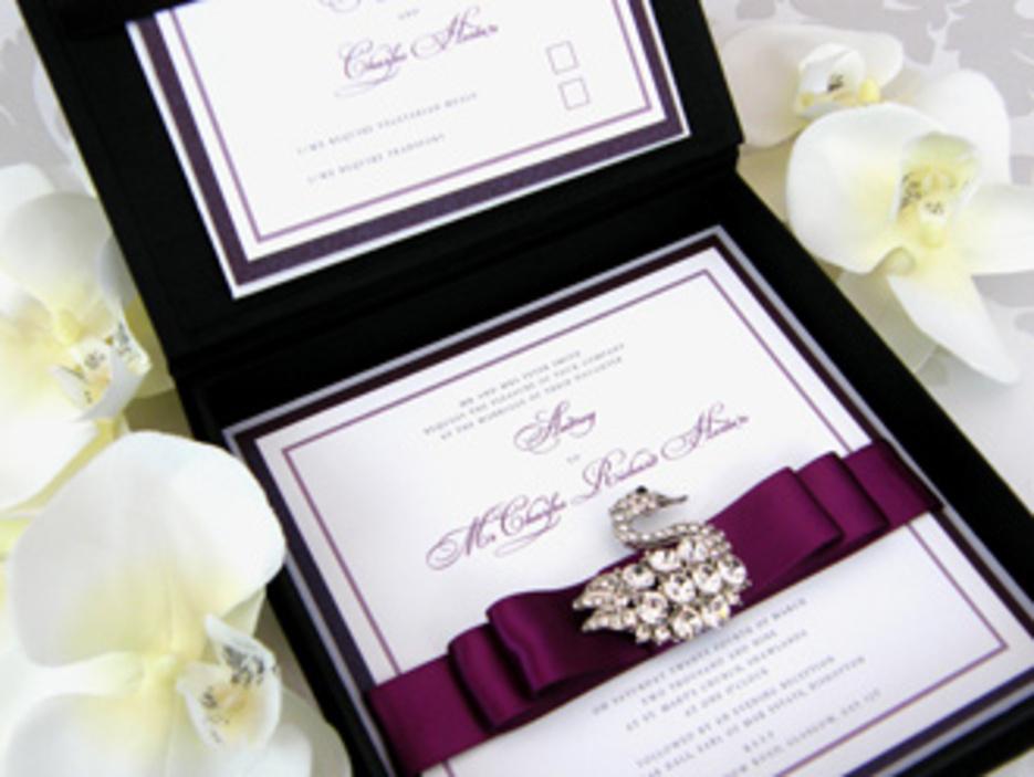 Classic white wedding invitation with romantic purple floral design