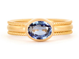 photo of Sapphire engagement ring with thick yellow gold band