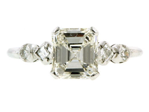 Emerald cut vintage diamond engagement ring