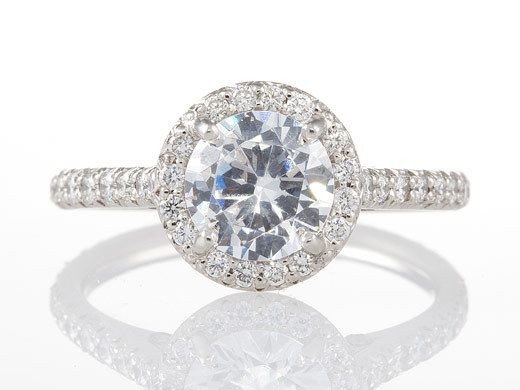 Round diamond engagement ring with pave diamonds and platinum setting