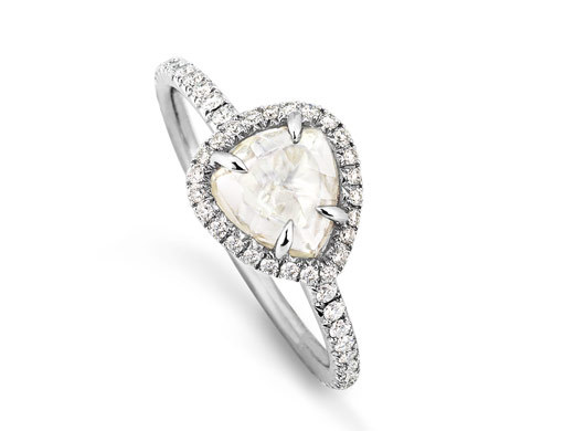 diamond engagement ring featuring uncut pear-shaped center stone