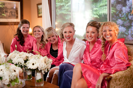 Bridesmaids in pink getting ready robes