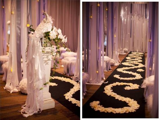 Elegant white wedding ceremony decor and aisle covered in white rose petals