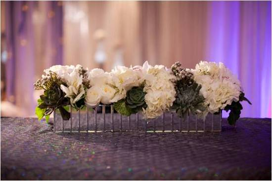 Romantic and classic wedding ceremony floral arrangement with white roses and luscious succulents
