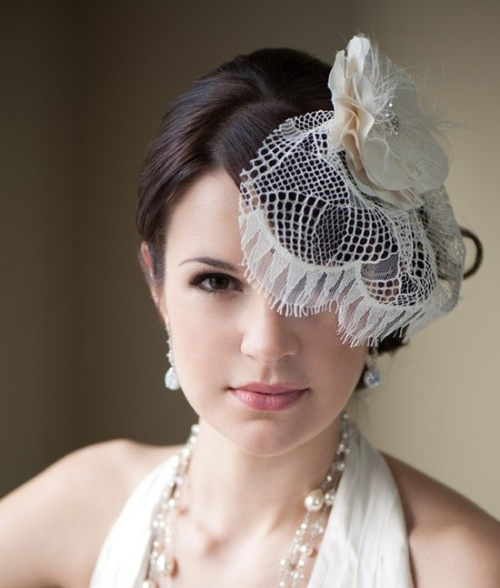 Vintage-inspired ivory lace bridal veil and mini hat