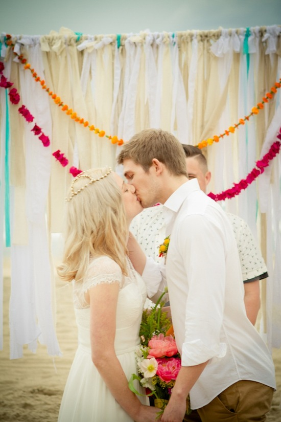 Beach ceremony kiss