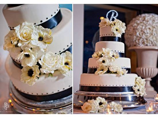 Chic ivory 3 tier wedding cake with black ribbon detail and crystal monogram cake topper