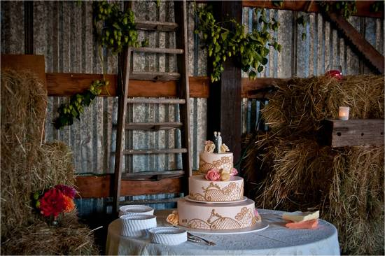 Rustic barn wedding venue with vintage-inspired 3-tier wedding cake