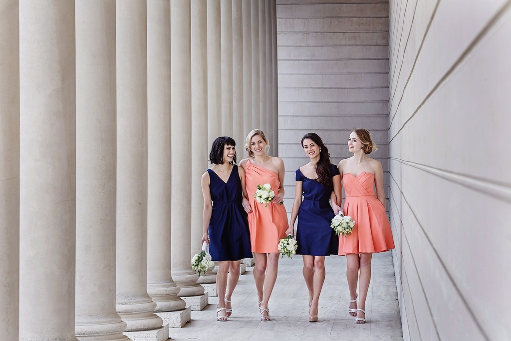 Midnight_blue_and_peach_bridesmaids_dresses_by_weddington_way.full