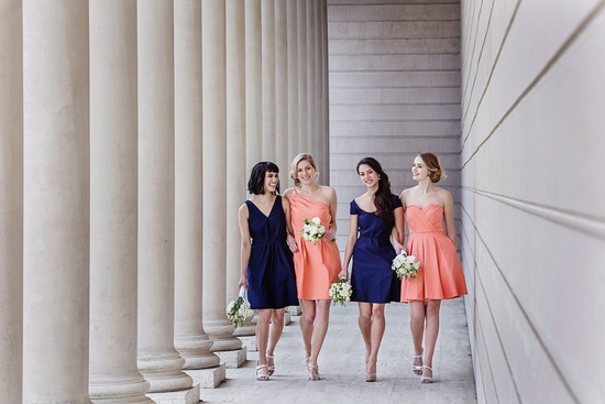 Midnight blue and peach bridesmaids dresses by Weddington Way