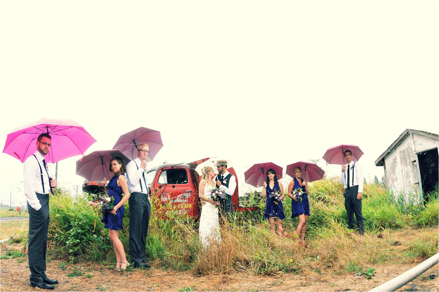 bride groom and wedding party pose outside with colorful