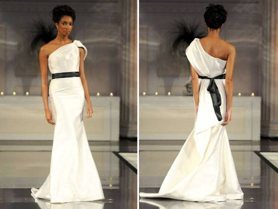 One-shoulder ivory mermaid wedding dress with black bridal sash