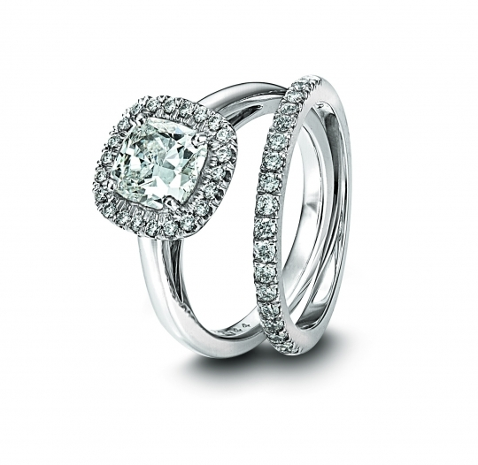 Cushion-cut diamond engagement ring with pave diamond wedding band