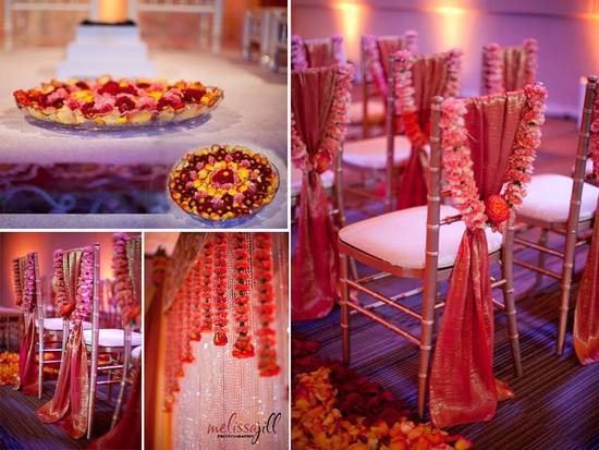 Vibrant red/orange wedding ceremony room with luxe decor