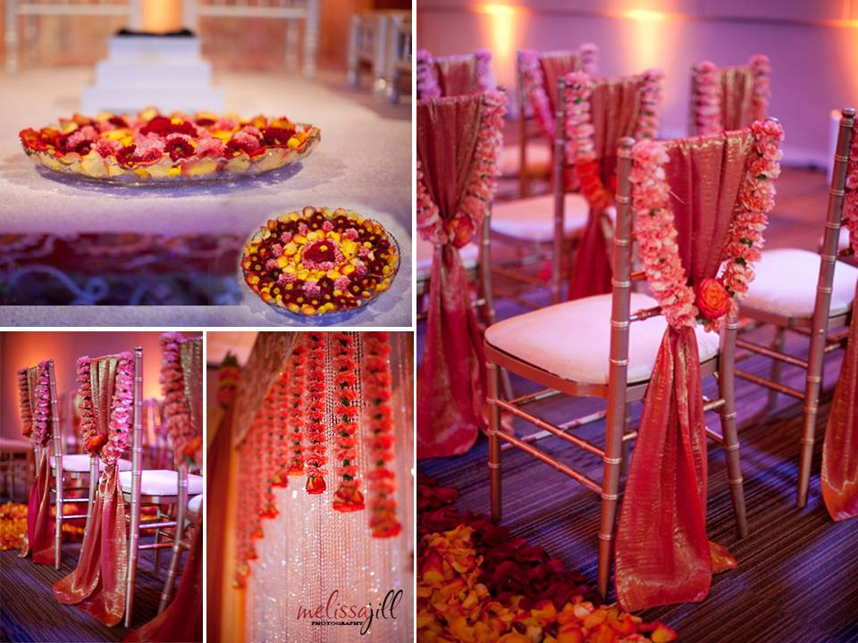 Vibrant red orange wedding ceremony room with luxe decor for Asian wedding room decoration
