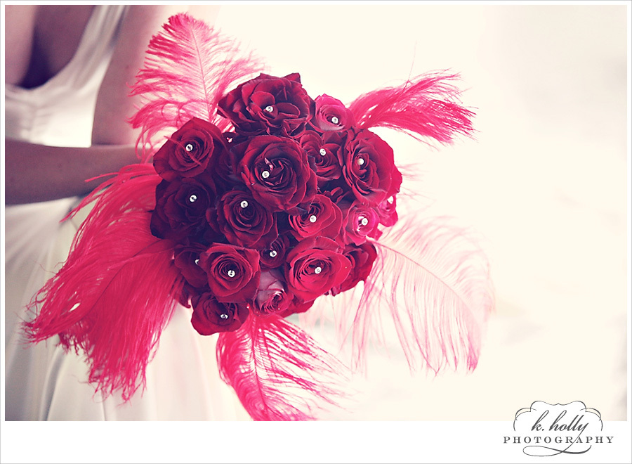 Monochromatic red rose bridal bouquet with vintage feathers and rhinestone details