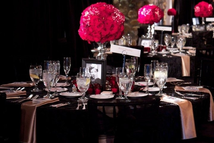 Old Hollywood Glam wedding tablescape- red rose topiaries, black table linens