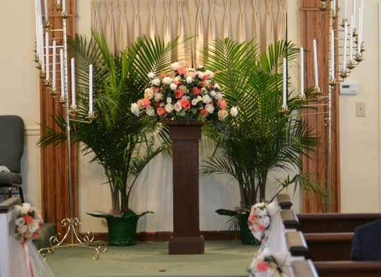 Custom coral altar and pew flowers small (760x554)