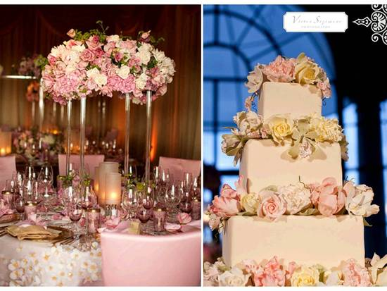 Stunning statement floral centerpiece with romantic ivory and pink roses; classic white wedding cake
