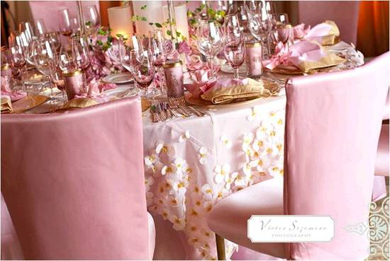Gorgeous pink and gold wedding reception tablescape with lots of texture