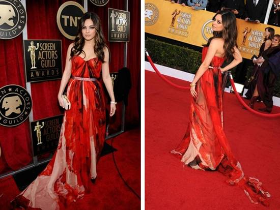Mila Kunis wears red and black Alexander McQueen chiffon gown