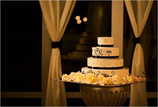 Classic 4-tier white wedding cake with black scroll pattern